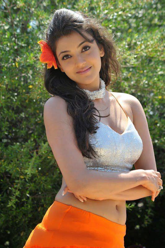 Kajal Agarwal Navel Cleavage In Orange Skirt